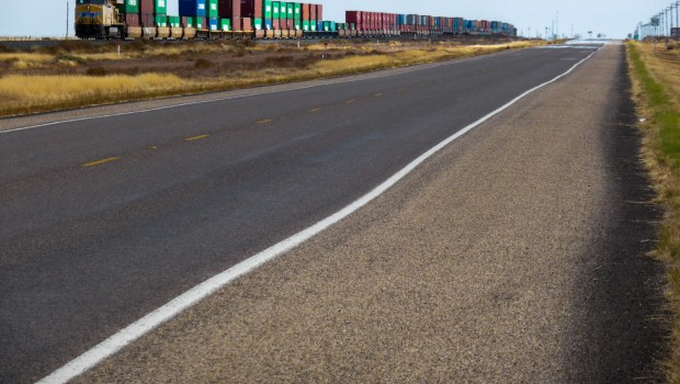 A train and a straight stretch of road