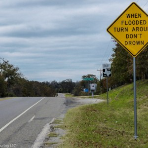 Road signs reading When Flooded Turn around Don't Drown