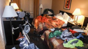 Hotel room with cycle gear strewn throughout.