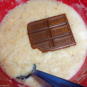 Hot cereal and a chocolate bar in a bowl