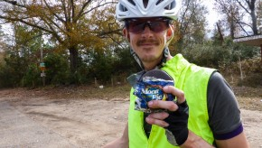 A bicyclist holds up a Moon Pie