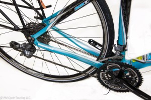 Rear triangle of the bicycle with rear derailleur attached and chain on.