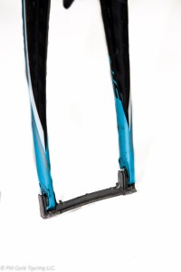 Front fork with plastic spacer to prevent bending during transit.