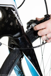 Positioning the front brake calipers before attaching to the fork.