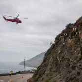 Helicopter over Pacific Coast Highway 1 near Lime Kiln, California. Major road construction was in progress and they were lifting workers from the road up the mountain.