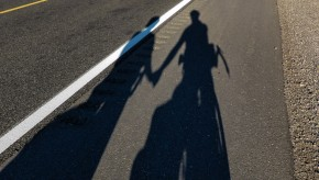 Shadows of Pam & Matt on a road outside Hope Arizona.