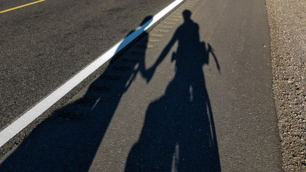 Shadows of Pam & Matt on a road outside Hope Arizona.