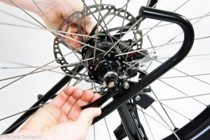 Removing the wheel from the bike by unscrewing the quick release skewers
