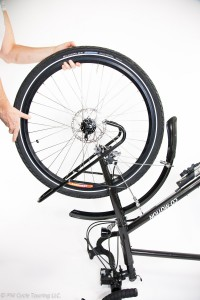 Removing the wheel from the bicycle.
