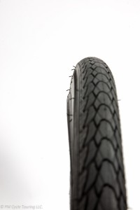 Straight on view of a tire, notice the hook (the bump on the inner edge of the tire which will engage with the rim to keep the tire on the wheel)