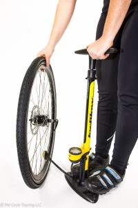Inflating a tire with a stand up bicycle pump.