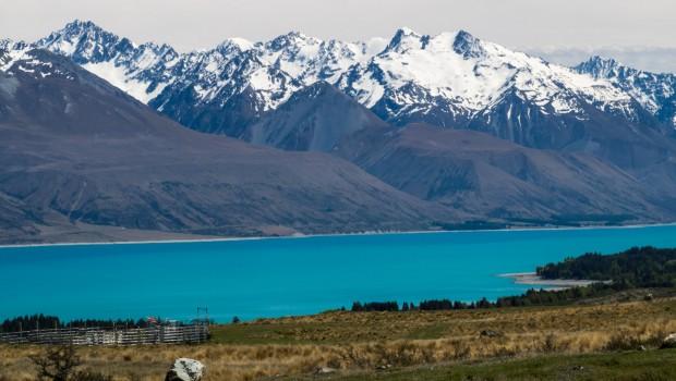Teal blue Lake Pukaki and snow capped mountains