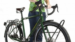 A woman stands with her Co-motion touring bicycle
