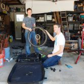 Pam and I holding the front tire as we pack Matt's bike